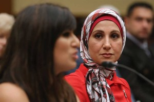 Sarah Hekmati listens as Nagameh Abedini addresses the House Foreign Affairs Committee (Chip Somodevilla/Getty Images).